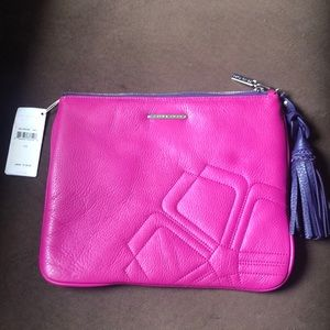Trina Turk fuchsia clutch with purple tassel